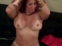 Nude female bodybuilder gives handjob