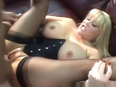 Huge breasted mature blonde in black stockings reveals her kinky side