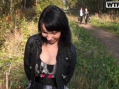 Slutty brunette sucks a dick for the money in the forest