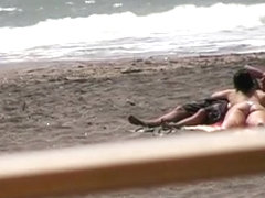 Nude hot ass brunette gives blowjob and hand job on the beach