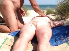 Oiling the beach wife