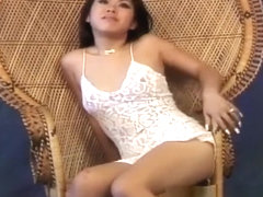 Miki Chan poses on and by her wicker chair showing nice skin
