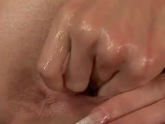 Liz oiles her big ass and starts masturbating hard