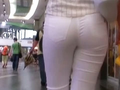 Beauty in tight white pants stars in a candid street video