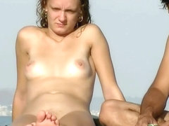 Nudist girl's tiny pussy in full sight