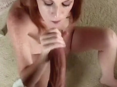 Hung dude has a sweet redhead sucking and stroking his dick POV style
