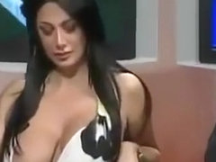 Famous Italian TV host with large boobs desperately tries to keep them in her dress