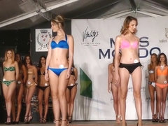 Beautiful models move on the catwalk in flimsy bikinis