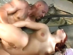 Nasty redhead with lovely tits has a black guy pounding her needy holes by the pool