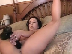 Becky in a bed masturbates a...