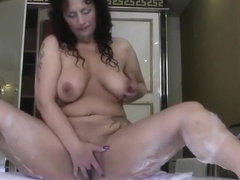 Curvy mom playing with her p...