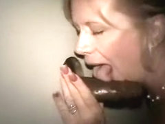 Hot blonde wife got her bald cunt penetrated through amateur gloryhole