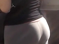 Sporty girl in tight gray sports pants