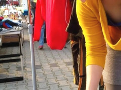 Street market seller has her big cleavage caught on the camera