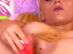Juliana lies on her bed fingering and toying her clit until she cums