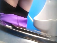 Purple pants woman pissing
