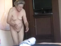 Granny caught dressing in bedroom