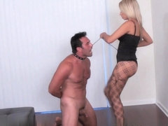 Seductive blonde busty babe and her slave