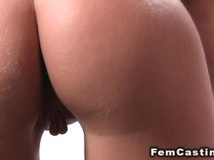 Female agent toy in front of amateur guy and assistant