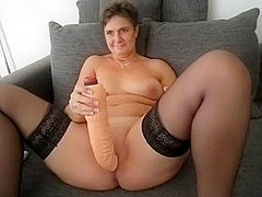 Nasty cougar having fun with sex toy
